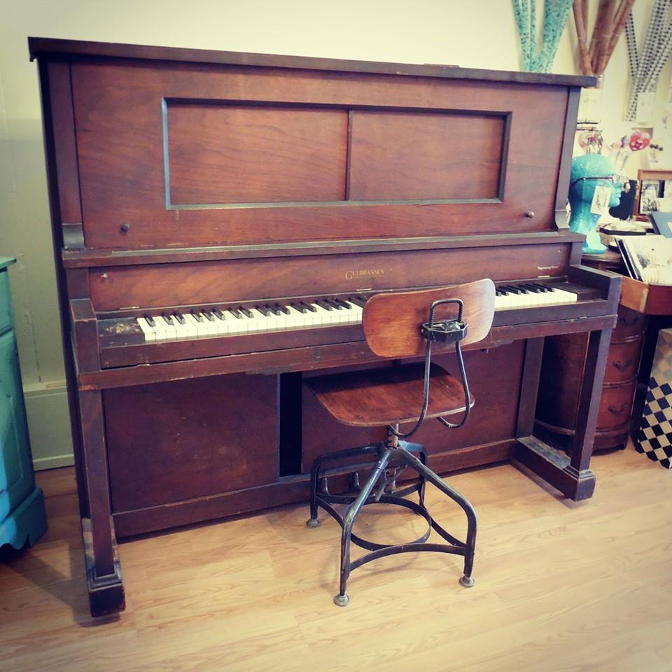 The 1924 Gulbransen was once a player piano but no longer has the player parts.