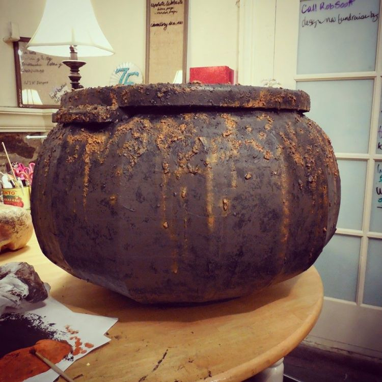 """The finished rusty cauldron waiting for a skull base and tissue paper """"fire""""."""