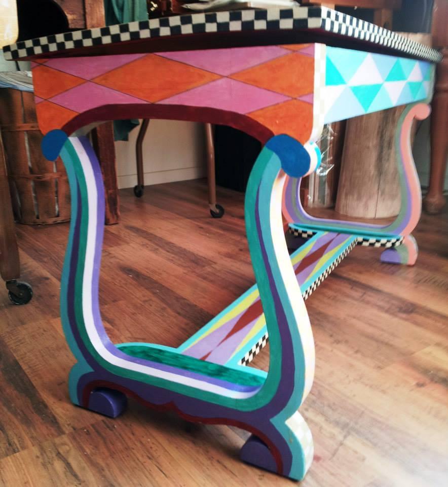 I love the musically inspired harp shaped legs!