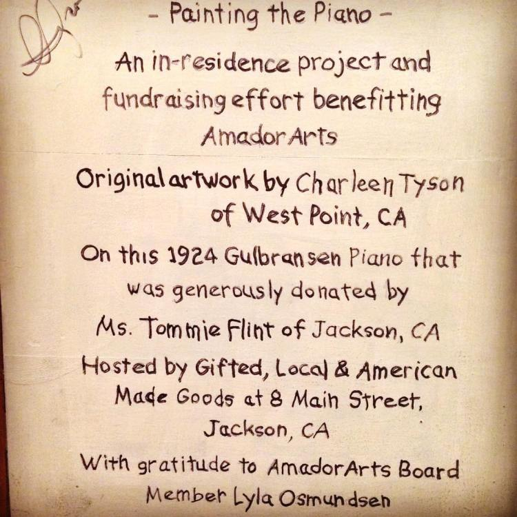 The dedication inscription that can be found on the back of the Painted Piano.